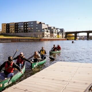 13 May, 2019.  Wisconsin Idea Seminar participants dock their canoes at the Milwaukee Rowing Club after a leisurely paddle on the Milwaukee River hosted by the Urban Ecology Center. (Photo by Bethany Prochnow/UW-Madison)