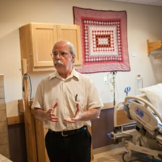 15 May, 2019.  Dr. James Deline, founder of the La Farge Medical Clinic and Center for Special Children, gives a tour of a birthing room equipped with a birthing tub and easy access to a garden patio, all in service of making labor and delivery as comfortable as possible. (Photo by Catherine Reiland/UW-Madison)