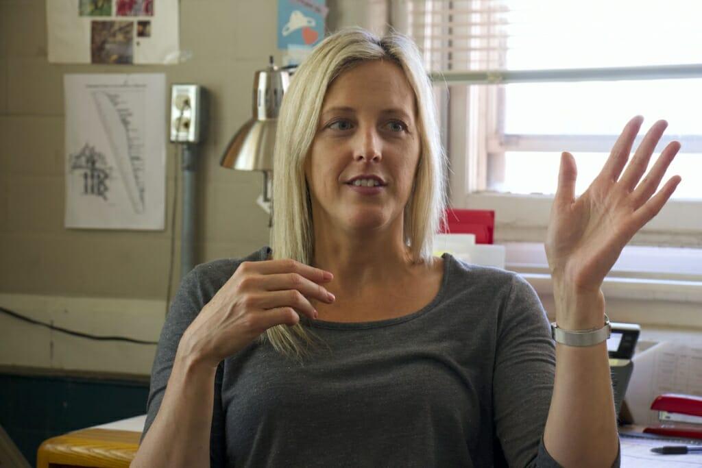 Photo: A woman gesticulates as she talks.