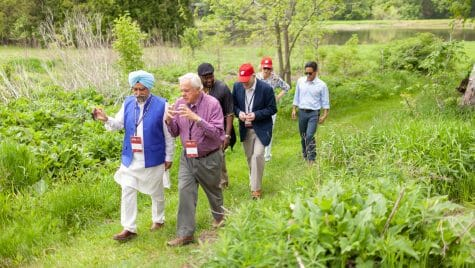 Photo: Group of people walking together on grassy trail