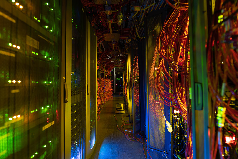 Photo: Colorful lights in dark computer server room