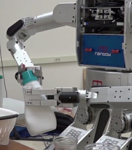 Photo: Robot twisting cap off of plastic jug