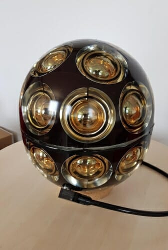 Photo: Spherical sensor module resting on table