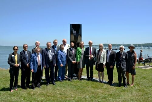 Photo: Group portrait of delegation standing in front of sculpture