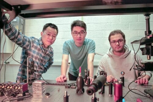 "<p>From left to right, Zongfu Yu, Ang Chen and Efram Khoram  developed the concept for a ""smart"" piece of glass that recognizes images without any external power or circuits.</p>"