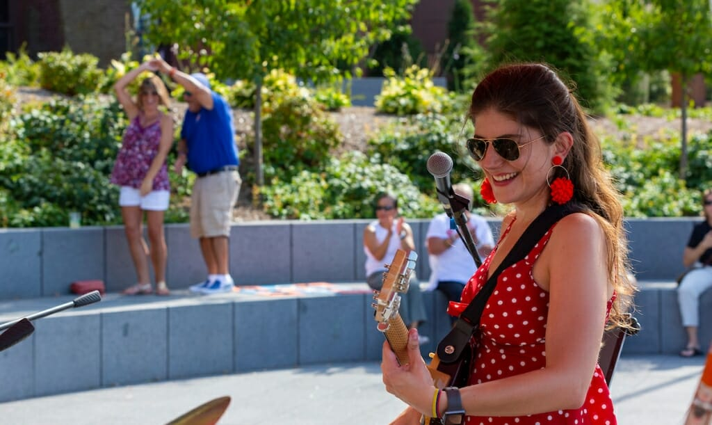 Photo: A woman plays her guitar