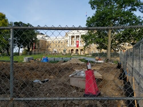Photo: Bascom Hall with ditch in front, behind chain link fence