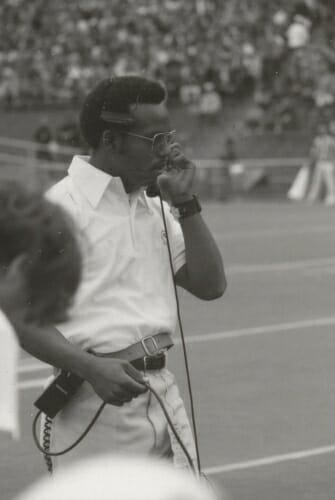 Photo: Martin speaking into headset on sideline