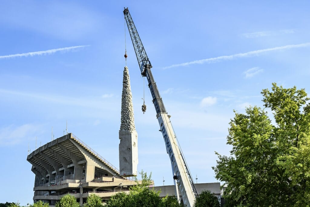 Photo: A crane transports a large statue.