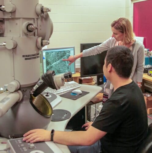 Photo: Woman pointing at screen while man looks