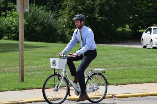 Photo: A man on a bike.
