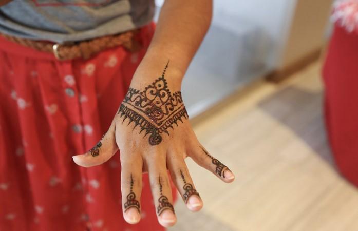 Closeup photo of the henna design on a hand