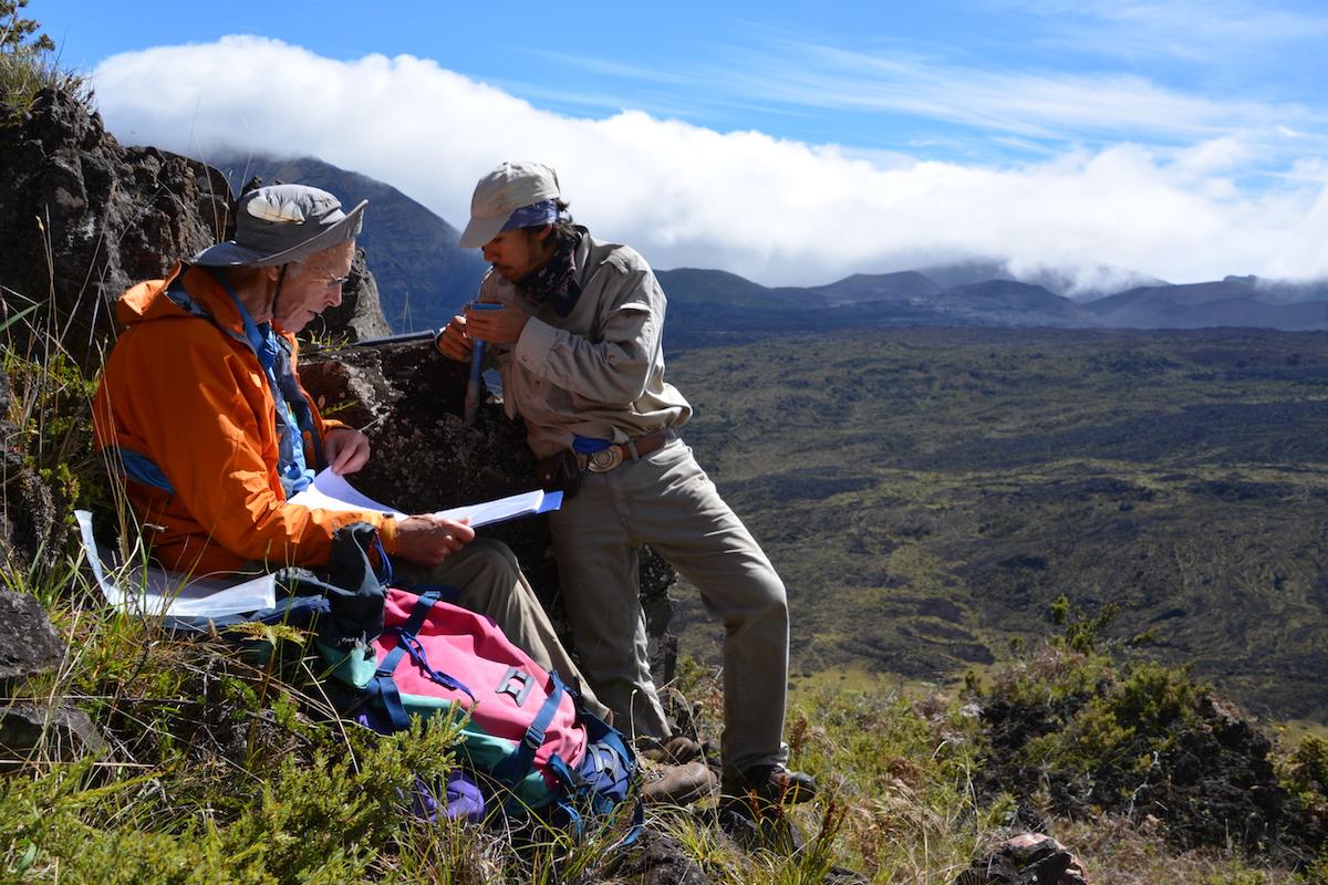 Photo: 2 men on side of lava flow site
