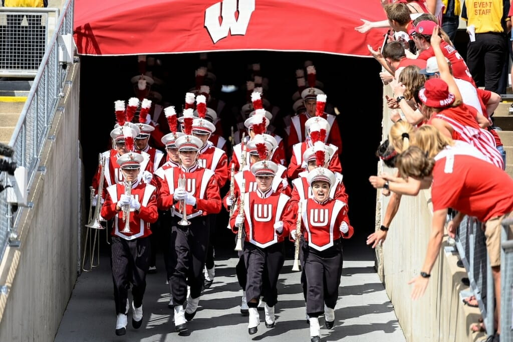 Photo: Uniformed band members marching through tunnel