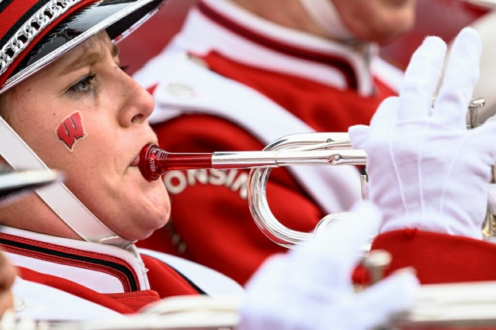 Photo: Band member with motion-W on cheek
