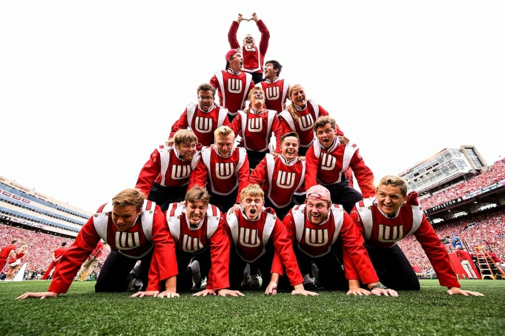 Photo: Band members in uniform making human pyramid