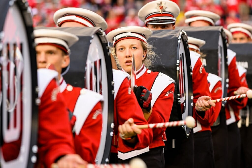 Photo: Band members marching with drums and cymbals