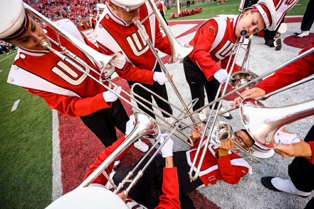 Photo: Band members with trombones intersecting