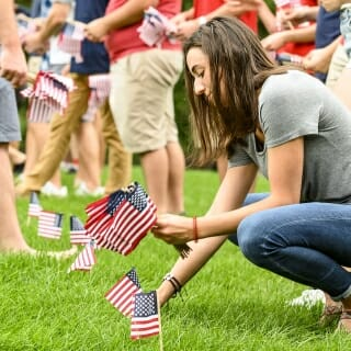 Sara Sedgwick places a flag on Bascom Hill to commemorate the victims of the terror attacks on Sept. 11, 2001.