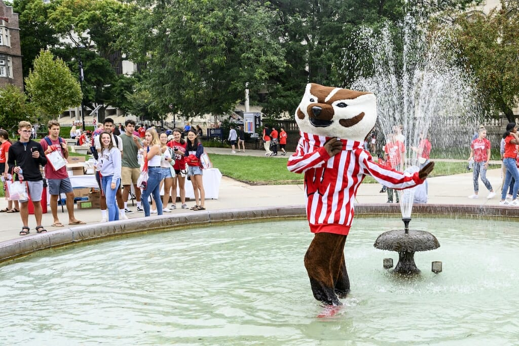Photo: Bucky Badger wades in the Haggenah Fountain.