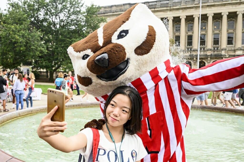 Photo: A woman takes a selfie with Bucky Badger.