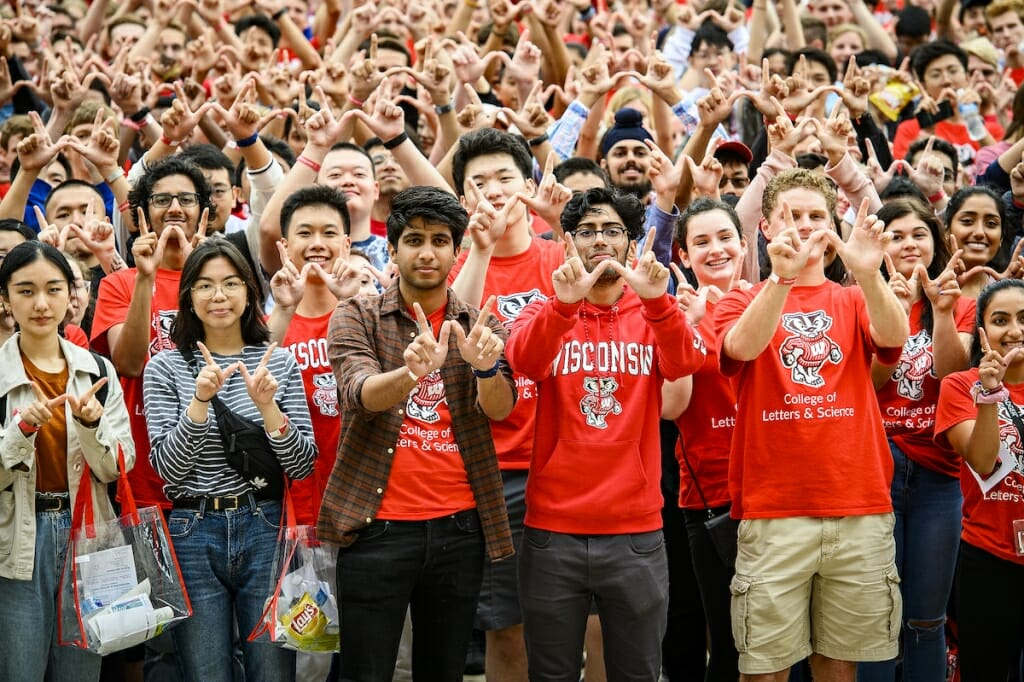 Photo: A crowd of red-clad freshman mug for the camera.