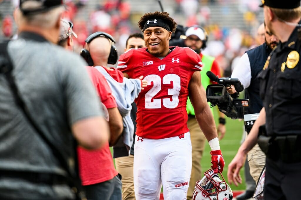 Wisconsin running back Jonathan Taylor (23) is tired but happy after his big game.