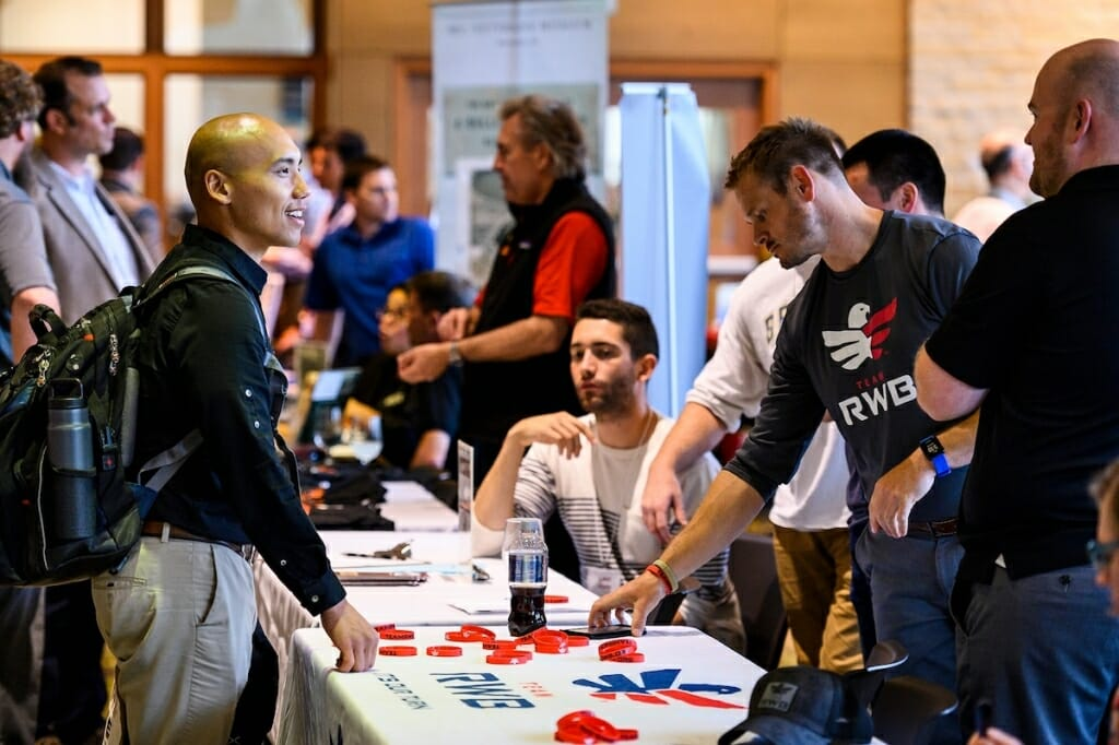 Photo: Student veteran standing at information table