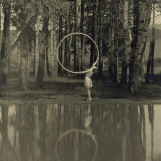 Student dancing with a hoop, one of many devices H'Doubler used to facilitate movement exploration, circa 1920.