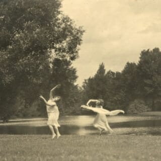 Two of Margaret H'Doubler's students dancing lakeside, circa 1920s.