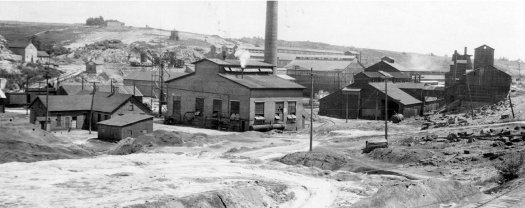 Black and white photo of an old lead and zinc mine.