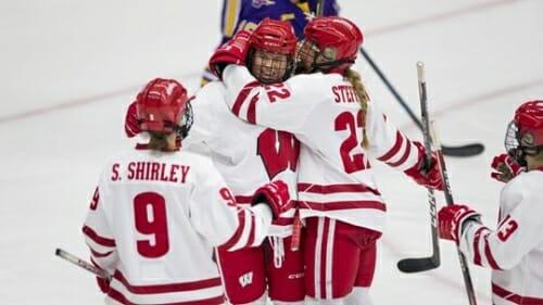 Hockey players hug.