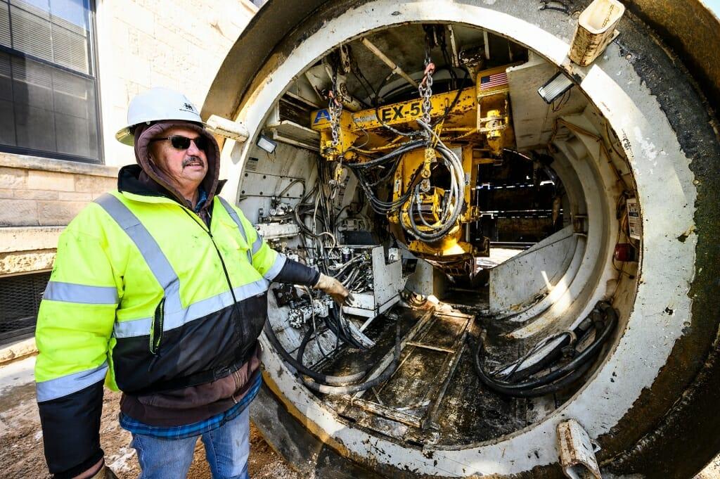 Patrick Minger, CEO of Minger Construction of Jordan, Minn., explains how his company's custom-made 11-foot diameter tunnel bore head works.