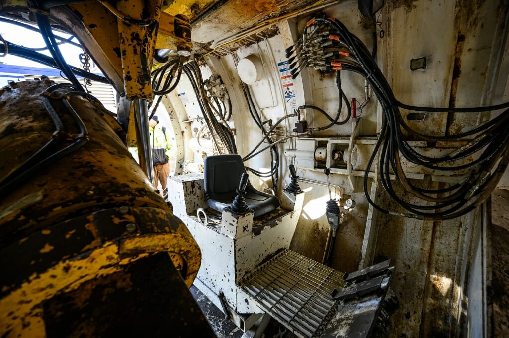 An operator sits here inside the tunnel bore head.