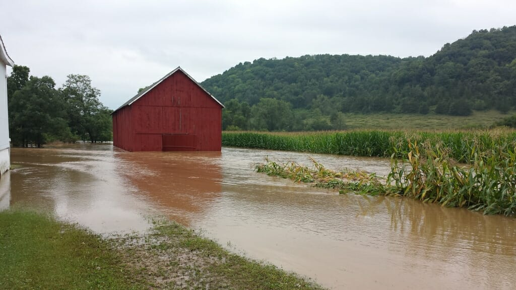 Photo: A field and barn are filled with water.
