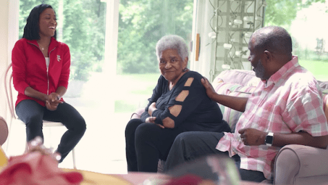 Photo: Alex Gee sitting in living room with mother Verline and daughter Lexi