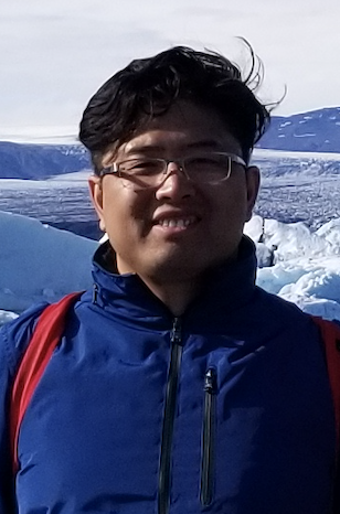 Photo: Portrait of Feng He standing in front of ice formation in Iceland