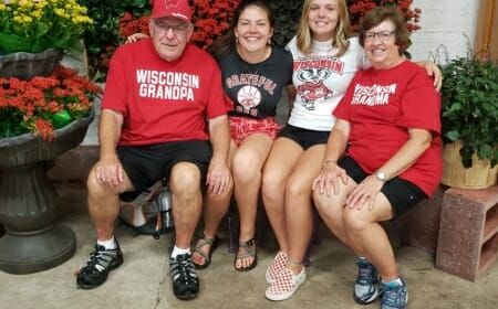 Photo: Four people sit on a bench.