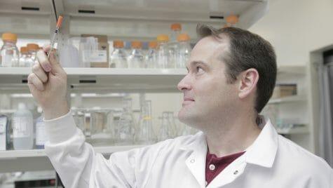 Photo: Kip Ludwig looking at a syringe