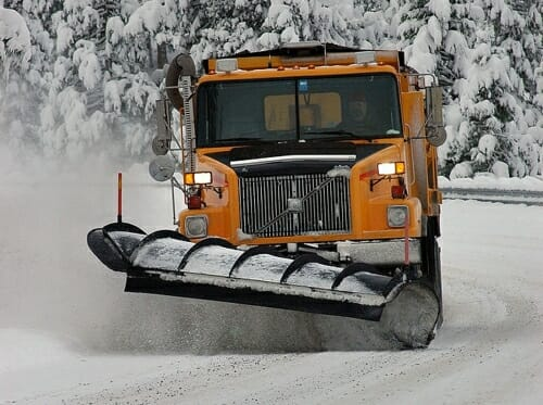 A snow plow clears snow