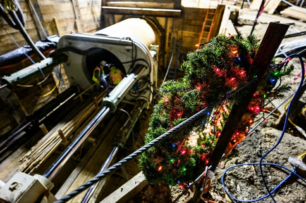 A wreath decorates some construction equipment in a pit.