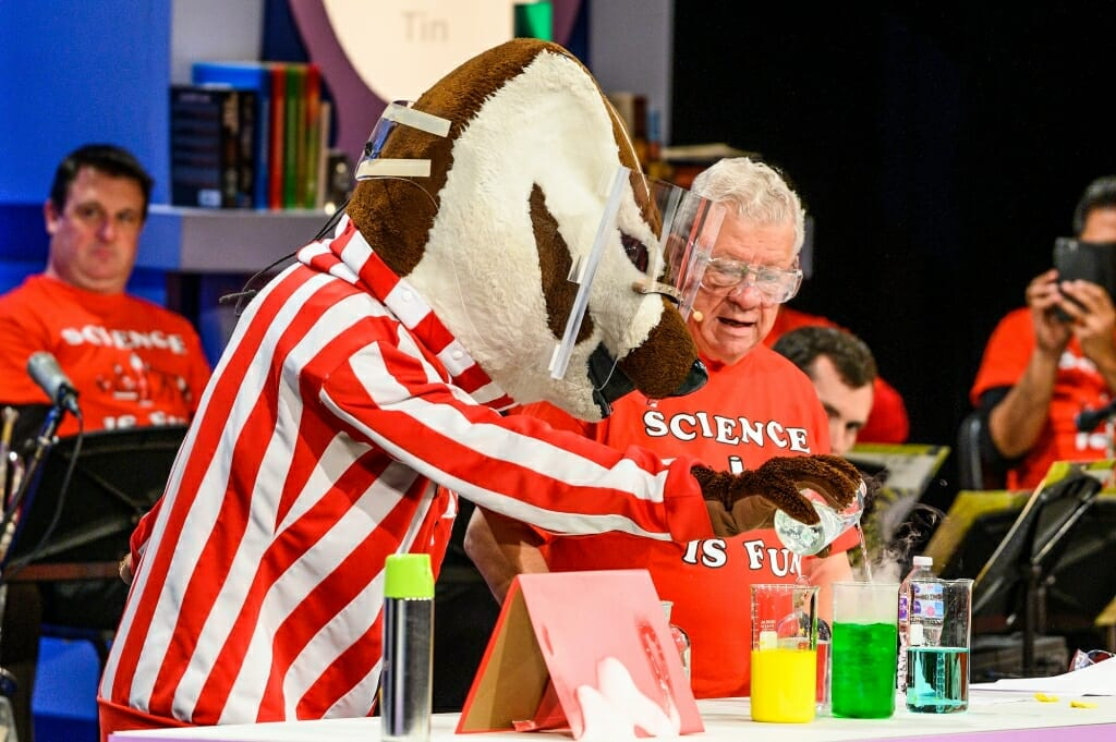 Photo of Bucky Badger pouring a chemical into a flask.
