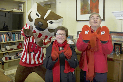 Photo: Bucky Badger, Becky Blank and Hanns Kuttner throwing the W