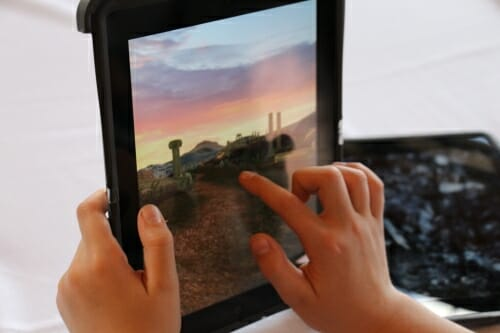Photo: Hands of child tapping on tablet computer screen