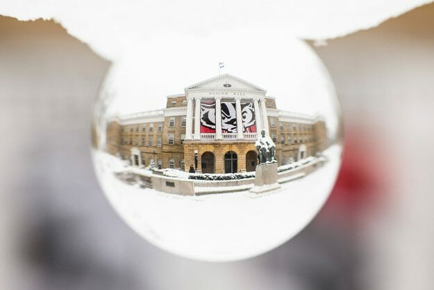 Bascom Hall as seen through a glass sphere in the snow