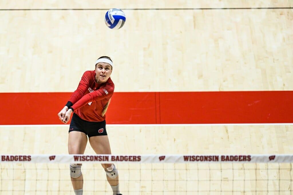 Photo: Tiffany Clark (17) digs the ball.