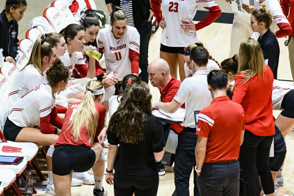Photo: Head coach Kelly Sheffield talks with the team during a time out.