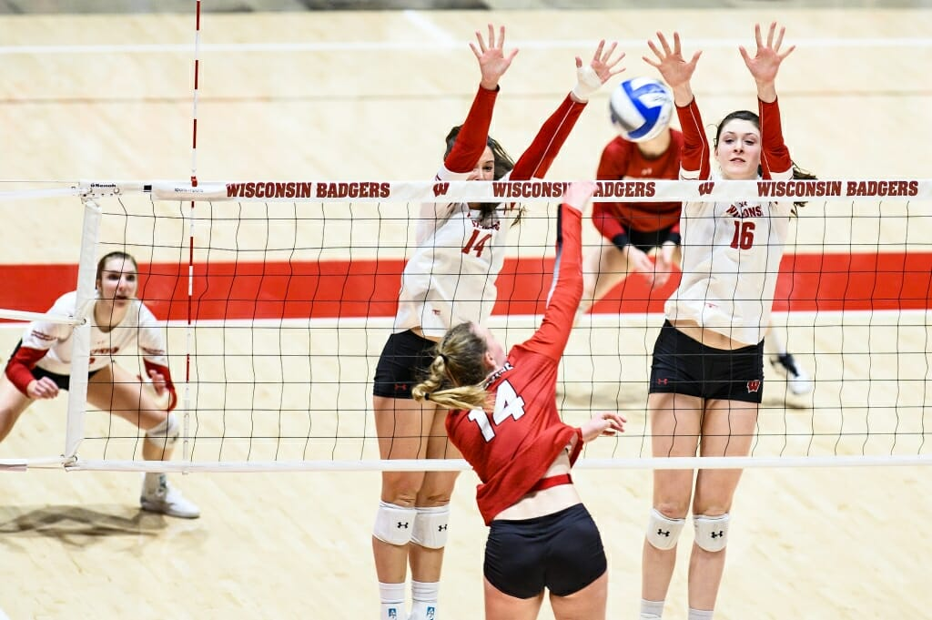 Photo: Madison Duello (14) and Dana Rettke (16) go up for the block.