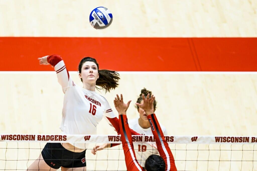 Photo: Dana Rettke (16) goes up to spike the ball.