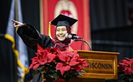 Photo of Lisa Kamal pointing toward the audience.